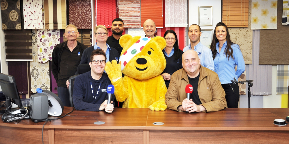 The UC Blinds Team with Pudsey Bear & BBC Radio WM 95.6FM's Danny Kelly & Kevin Pashby